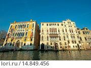 Купить «Colorful house with flags and striped poles, Ponte dell´Accademia bridge, Venice, Italy.», фото № 14849456, снято 1 декабря 2011 г. (c) age Fotostock / Фотобанк Лори