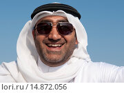 Купить «Arabian man of Dubai wearing traditional dress of dishdasha (robe) and kaffiyeh (head covering, held in place by a rope called the agal); United Arab Emirates.», фото № 14872056, снято 14 марта 2010 г. (c) age Fotostock / Фотобанк Лори