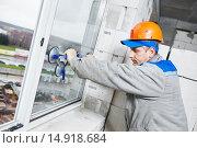 Купить «window installation or glazing», фото № 14918684, снято 19 ноября 2015 г. (c) Дмитрий Калиновский / Фотобанк Лори
