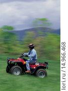 Купить «Driving ATV Through Grass», фото № 14966468, снято 11 июня 2005 г. (c) age Fotostock / Фотобанк Лори