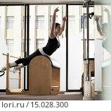 Купить «Woman exercising», фото № 15028300, снято 15 января 2009 г. (c) age Fotostock / Фотобанк Лори