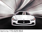Купить «White 2014 Maserati Ghibli S Q4 luxury car speeding in a tunnel. Front view.», фото № 15029964, снято 20 июня 2019 г. (c) age Fotostock / Фотобанк Лори