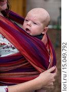 Купить «Denver, Colorado - Mariel West, 26, carries her two-month-old son, Adam Hjermstad Jr.», фото № 15049792, снято 30 августа 2014 г. (c) age Fotostock / Фотобанк Лори