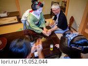 Купить «Fukuyu,geisha and Fukukimi,´maiko´ (geisha apprentice) workimg in Miyaki tea house (o-chaia).Geisha´s distric of Miyagawacho.Kyoto. Kansai, Japan.», фото № 15052044, снято 15 июля 2020 г. (c) age Fotostock / Фотобанк Лори