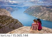 Купить «Preikestolen, Pulpit Rock, 600 meters over LyseFjord, Lyse Fjord, in Ryfylke district, Rogaland Region, It is the most popular hike in Stavanger area, Norway.», фото № 15065144, снято 15 июля 2020 г. (c) age Fotostock / Фотобанк Лори