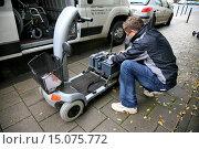 Купить «man changing power supply of mobility scooter», фото № 15075772, снято 31 октября 2008 г. (c) age Fotostock / Фотобанк Лори