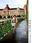 Купить «Girl riding her bicycle on the green zabadsag bridge over the river Danube in Budapest.», фото № 15106816, снято 10 июля 2012 г. (c) age Fotostock / Фотобанк Лори