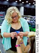 Купить «Detroit, Michigan - Students compete to make tiny maglev vehicles at the Intelligent Transport Systems World Congress.», фото № 15420184, снято 10 сентября 2014 г. (c) age Fotostock / Фотобанк Лори