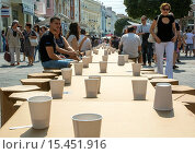 Купить «Bulgarians drink wine and wear special costumes at a 500-meter-long table in the downtown Plovdiv, to celebrate the city's selection by an international...», фото № 15451916, снято 13 сентября 2014 г. (c) age Fotostock / Фотобанк Лори