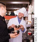 Купить «Happy chefs and waiter working», фото № 15539132, снято 21 апреля 2019 г. (c) Яков Филимонов / Фотобанк Лори