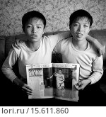 Купить «Twins Holding French Magazine Article About Football, Jung Pyong Ri, North Korea», фото № 15611860, снято 8 мая 2010 г. (c) age Fotostock / Фотобанк Лори
