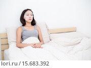 Купить «Woman relaxing in bed with her mask sheet», фото № 15683392, снято 23 апреля 2019 г. (c) PantherMedia / Фотобанк Лори