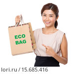 Купить «Asian woman finger point to shopping bag and showing phrase of eco bag», фото № 15685416, снято 20 ноября 2019 г. (c) PantherMedia / Фотобанк Лори