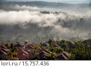 Купить «Early morning sun dissipates sea mist around residential homes in Crown Valley in coastal Laguna Niguel, CA.», фото № 15757436, снято 22 октября 2014 г. (c) age Fotostock / Фотобанк Лори