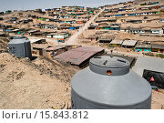 Купить «A large plastic water tanks, used for water storage, are seen on the dusty hillside of Pachacútec, a desert suburb of Lima, Peru, 20 January 2015. Although...», фото № 15843812, снято 20 января 2015 г. (c) age Fotostock / Фотобанк Лори