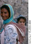 Купить «Portrait of Kurdish mother carrying child in sling on her back.», фото № 15859488, снято 11 октября 2008 г. (c) age Fotostock / Фотобанк Лори