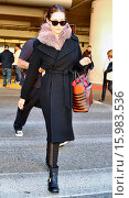 Купить «Emmy Rosssum wrapped up warm in a long coat and biker boots, returns home for the holidays by way of at Los Angeles International Airport (LAX) Featuring...», фото № 15983536, снято 28 декабря 2014 г. (c) age Fotostock / Фотобанк Лори