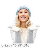 Купить «woman in winter heat showing empty palms», фото № 15991316, снято 8 октября 2015 г. (c) Syda Productions / Фотобанк Лори