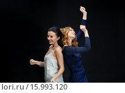 Купить «happy young women dancing at night club disco», фото № 15993120, снято 21 ноября 2015 г. (c) Syda Productions / Фотобанк Лори