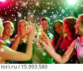 Купить «smiling friends with glasses of champagne in club», фото № 15993580, снято 20 октября 2014 г. (c) Syda Productions / Фотобанк Лори