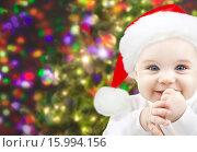 Купить «happy baby in santa hat over christmas lights», фото № 15994156, снято 22 декабря 2007 г. (c) Syda Productions / Фотобанк Лори