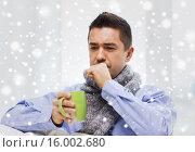 Купить «ill man with flu drinking tea and coughing at home», фото № 16002680, снято 29 января 2015 г. (c) Syda Productions / Фотобанк Лори