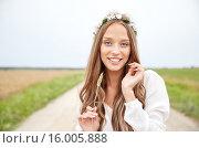 Купить «smiling young hippie woman on cereal field», фото № 16005888, снято 27 августа 2015 г. (c) Syda Productions / Фотобанк Лори