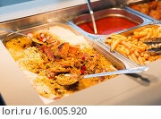 Купить «close up of rice pilaf and other dishes on tray», фото № 16005920, снято 15 октября 2015 г. (c) Syda Productions / Фотобанк Лори