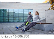 Купить «couple doing triceps dip exercise outdoors», фото № 16006700, снято 17 октября 2015 г. (c) Syda Productions / Фотобанк Лори