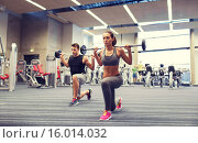 Купить «young man and woman training with barbell in gym», фото № 16014032, снято 30 ноября 2014 г. (c) Syda Productions / Фотобанк Лори
