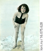 Купить «United States: 1930. This beauty looks ready to ride the waves in this studio shot. Half aquaplane, half surfboard, her wild bathing suit represents the future of wave riding.», фото № 16075628, снято 15 октября 2018 г. (c) age Fotostock / Фотобанк Лори