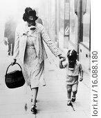 Купить «London, England: September 12, 1941.A woman shopper and her child wearing gas masks pass through a gas drill area in Wembley.», фото № 16088180, снято 18 февраля 2019 г. (c) age Fotostock / Фотобанк Лори