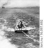 Купить «Coronado, California: c. 1932.Actress Alice White steadies herself on her aquaplane.», фото № 16097692, снято 18 августа 2018 г. (c) age Fotostock / Фотобанк Лори