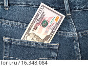 Купить «Fifty dollars bill sticking out of the back jeans pocket», фото № 16348084, снято 17 августа 2018 г. (c) FotograFF / Фотобанк Лори