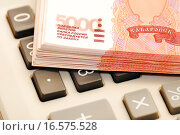 Купить «Деньги лежат на калькуляторе», эксклюзивное фото № 16575528, снято 2 марта 2011 г. (c) Юрий Морозов / Фотобанк Лори