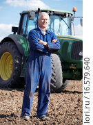 Driver Standing In Front Of Tractor. Стоковое фото, фотограф Stockbroker / easy Fotostock / Фотобанк Лори