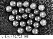Купить «Металлические шарики на деревянном столе», фото № 16721168, снято 20 апреля 2015 г. (c) Евгений Ткачёв / Фотобанк Лори
