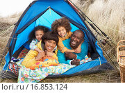 Купить «Young Family Relaxing Inside Tent On Camping Holiday», фото № 16853124, снято 29 марта 2020 г. (c) easy Fotostock / Фотобанк Лори
