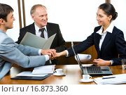 Купить «Photo of three partners holding the hands in the office», фото № 16873360, снято 17 сентября 2018 г. (c) easy Fotostock / Фотобанк Лори