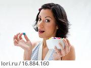 Купить «Happy beautiful candy girl with a bowl of colorful bubblegum candy balls licking her lip, isolated», фото № 16884160, снято 18 января 2009 г. (c) easy Fotostock / Фотобанк Лори