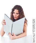 Купить «Beautiful young woman holding a laptop in improper way isolated on white», фото № 17035520, снято 19 июня 2019 г. (c) easy Fotostock / Фотобанк Лори