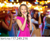 Купить «happy young woman or teen girl with party horn», фото № 17249216, снято 31 октября 2015 г. (c) Syda Productions / Фотобанк Лори