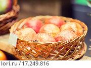 Купить «ripe pomegranates in basket at food market», фото № 17249816, снято 20 декабря 2014 г. (c) Syda Productions / Фотобанк Лори
