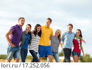 Купить «group of happy friends walking along beach», фото № 17252056, снято 31 августа 2013 г. (c) Syda Productions / Фотобанк Лори