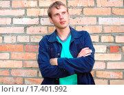 Купить «Young stylish man stand near brick wall.», фото № 17401992, снято 30 мая 2020 г. (c) easy Fotostock / Фотобанк Лори