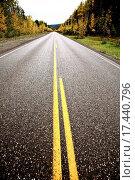 Купить «Centerlines along a paved road in autumn», фото № 17440796, снято 20 сентября 2019 г. (c) easy Fotostock / Фотобанк Лори