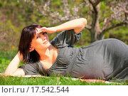 Купить «expectant mother reposes in town park», фото № 17542544, снято 19 сентября 2018 г. (c) easy Fotostock / Фотобанк Лори