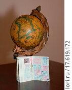 The globe and the passport. Стоковое фото, фотограф Valerijs Novickis / easy Fotostock / Фотобанк Лори