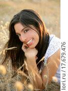 Купить «Beautiful indian brunette in a golden field», фото № 17679476, снято 21 сентября 2018 г. (c) easy Fotostock / Фотобанк Лори