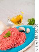 Купить «Raw hamburger», фото № 18150160, снято 22 апреля 2019 г. (c) easy Fotostock / Фотобанк Лори